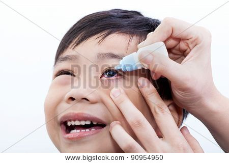Closeup Of Parent Pouring Eye Drops In Eye Her Son