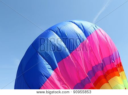 Colorful Hot Air Balloon Is Flying In The Blue Sky
