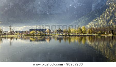 Reflection Of Village Obertraun In Hallstatt Lake