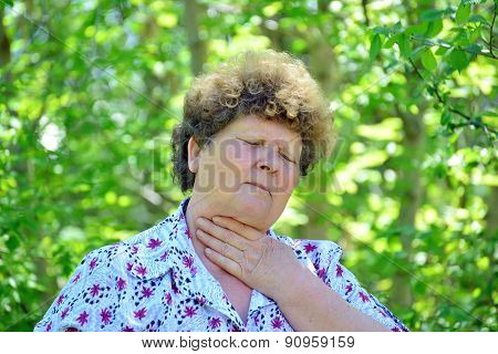Mature Woman With Sore Throat In Nature