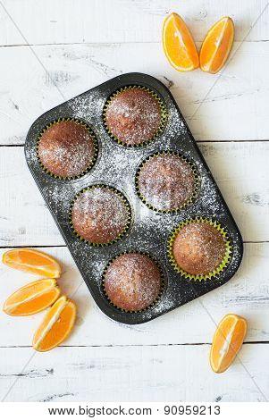 Orange Muffins In Baking Dish