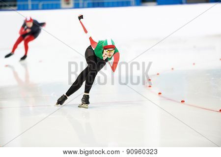 Speed skating young female sportsman during competition race