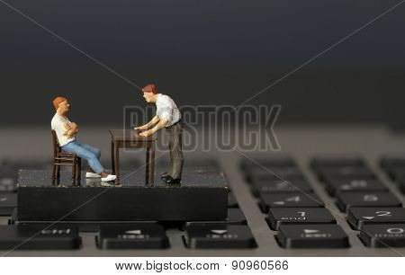 Working Online Concept-miniature Businessman Boss Angry With Employee On Laptop Computer
