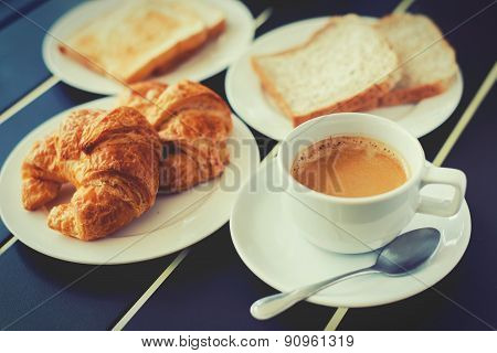 Croissant Breakfast Served With Black Coffee And Breakfast Menu