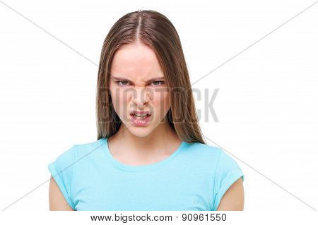 Aggressive Face Of A Young Girl Isolated On White.