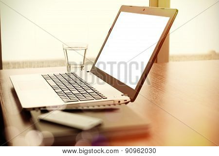 Office Workplace With Blank Screen Laptop And Smart Phone On Wood Table