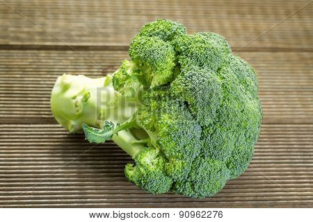 Fresh raw broccoli on a wooden table