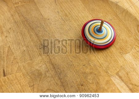 A wooden spinning-top in action