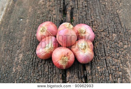 shallots on wood background