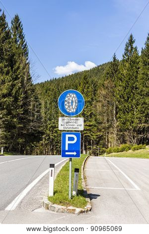 Snow Chain Sign With Parking Place To Change