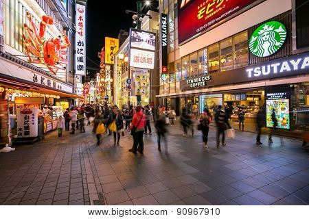 OSAKA, JAPAN - FEB 9: Unidentified tourists are shopping at Dotonbori on Febuary 9, 2015 in Osaka, Japan. With a history reaching back to 1612, the districtis now one of Osaka's tourist destinations.