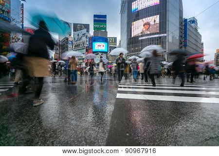 TOKYO - FEB 18: Pedestrians cross at Shibuya Crossing on Febuary 18, 2015 in Tokyo, Japan. The crosswalk is one of the world's most famous implementations of a scramble crosswalk.