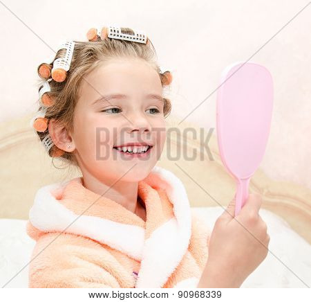 Cute Smiling Little Girl Looking At The Mirror