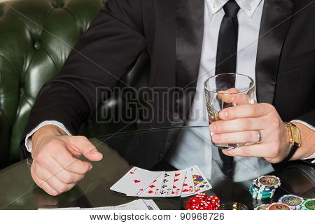 Poker player. Young guy in the casino at the gaming table.