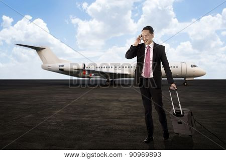 Man Walking While Calling On The Cellphone After Arriving With P