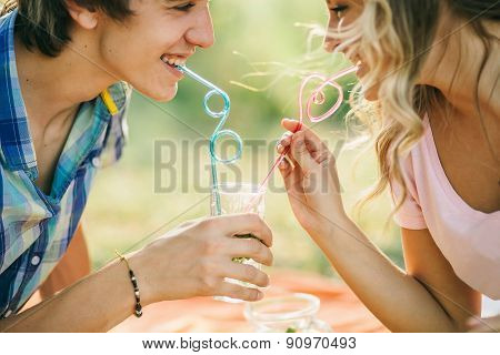 Teenage Couple Smiling With Cocktail