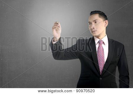 Asian Business Man Write Something