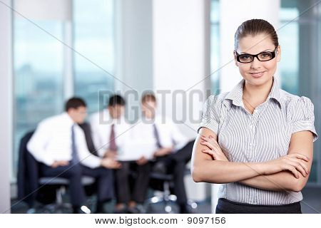 Girl On The Background Of Working Business