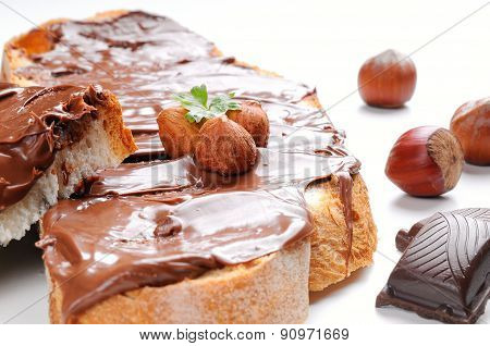 Two Slices Of Bread With Chocolate Cream And Hazelnuts Closeup