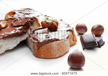 Two Slices Of Bread With Chocolate Cream And Hazelnuts Front