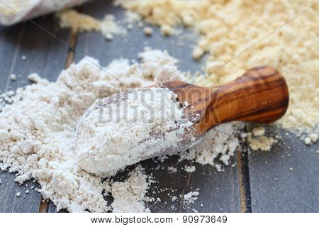 Gluten free oat flour in wooden scoop