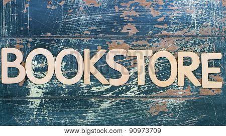 Word bookstore written with wooden letters on rustic wooden surface
