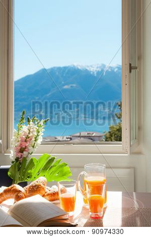 Interior home, traditional breakfast on the table, lake view