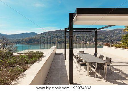 architecture, modern house, beautiful veranda overlooking the lake
