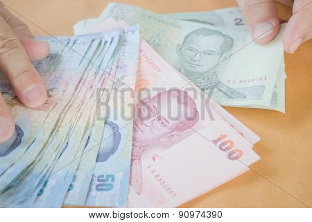 Man Hand Counting Thai Baht Banknote