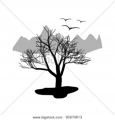 Landscape desert. Dry tree with mountains in the background. A flock of birds.