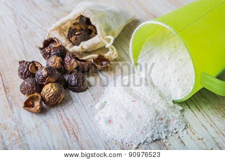 Natural Soapnuts And Washing Powder On White Table