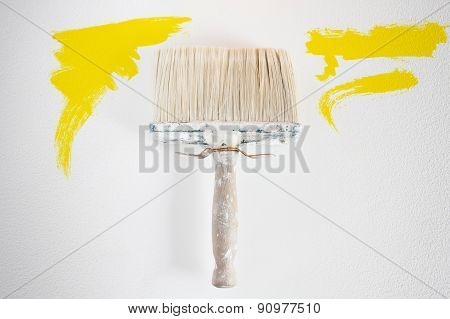 Dirty Wall Brush Painting With Yellow Paint