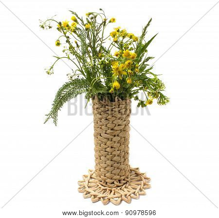 Wild Flowers In A Wicker Vase Isolated On White Background