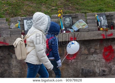 Kiev, Ukraine - October, 23, 2014: Live And Dead. Children On An Excursion On A Makeshift Memorial T