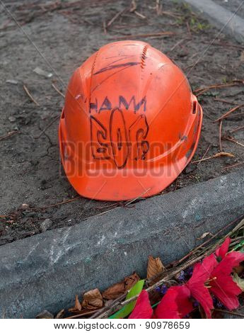 KIEV; UKRAINE - October; 27; 2014: Helmet deceased activist with the emblem and a stylized inscripti