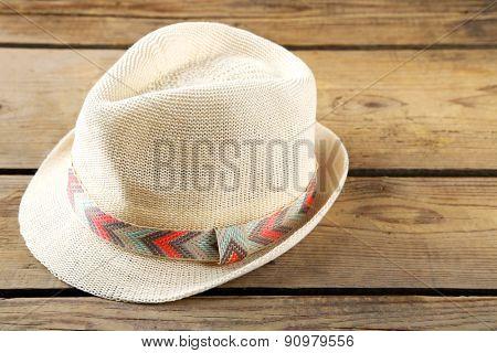 Beach hat on wooden background