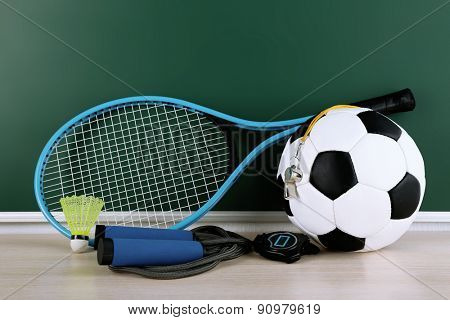 Sports equipment on blackboard background