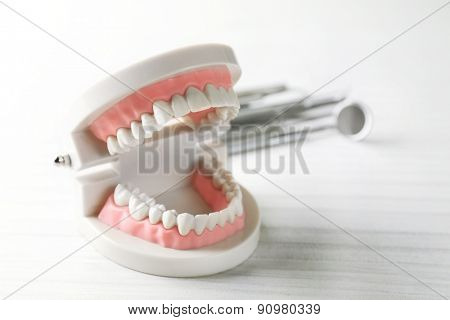 White teeth on table background