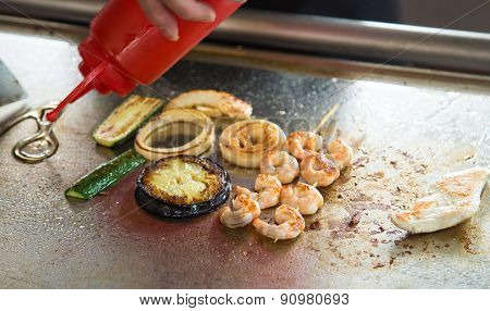 Cooking At The Restaurant Grilled Foods And Shrimp Skewers