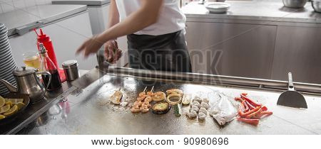 Restaurant With Grilled Foods And A Sole Fish