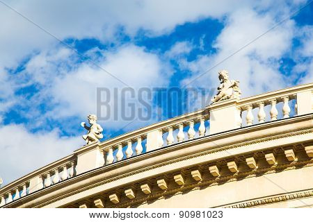 Sky background with Statues at the front facade of Burgtheater, Vienna