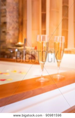 Two Glasses Of Champagne Near Jacuzzi. Abstract Blur Background With Bokeh