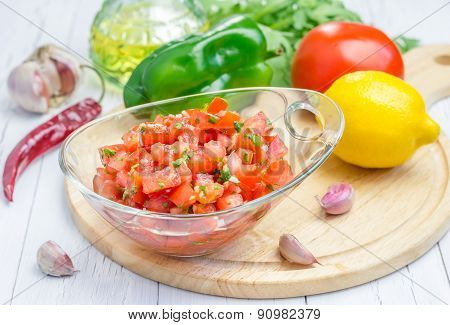 Bowl Of Fresh Homemade Salsa Dip And Ingredients