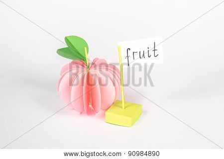 isolated paper apple with card with word