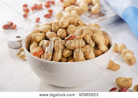 Peanuts In Shells In  White Bowl.