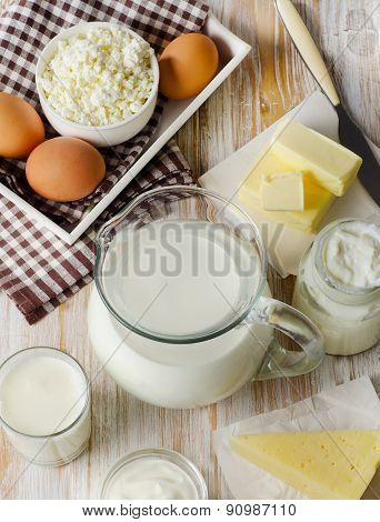 Milk Products On  Wooden Table.
