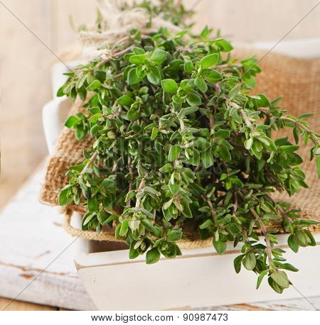 Thyme And Oregano In A White Wooden Box.