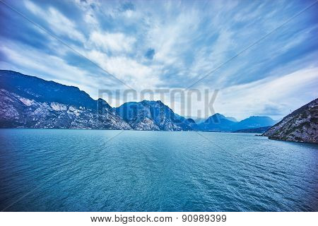 Lake With Blue Mountains And Sky