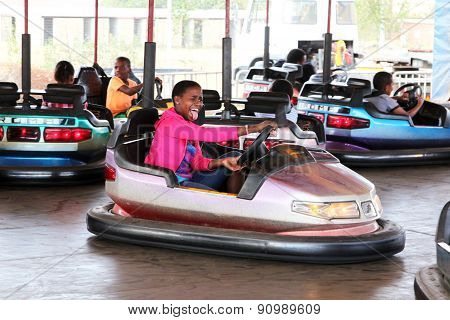Black African Girl Enjoying Bumper Cars