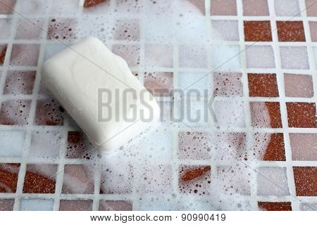 Soap with bubble on mosaic tiles background